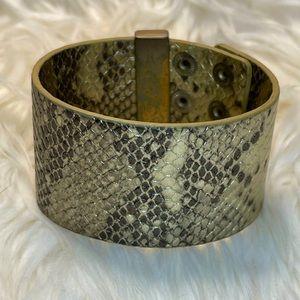 Gold tone/gray snakeskin printed wrap bracelet.